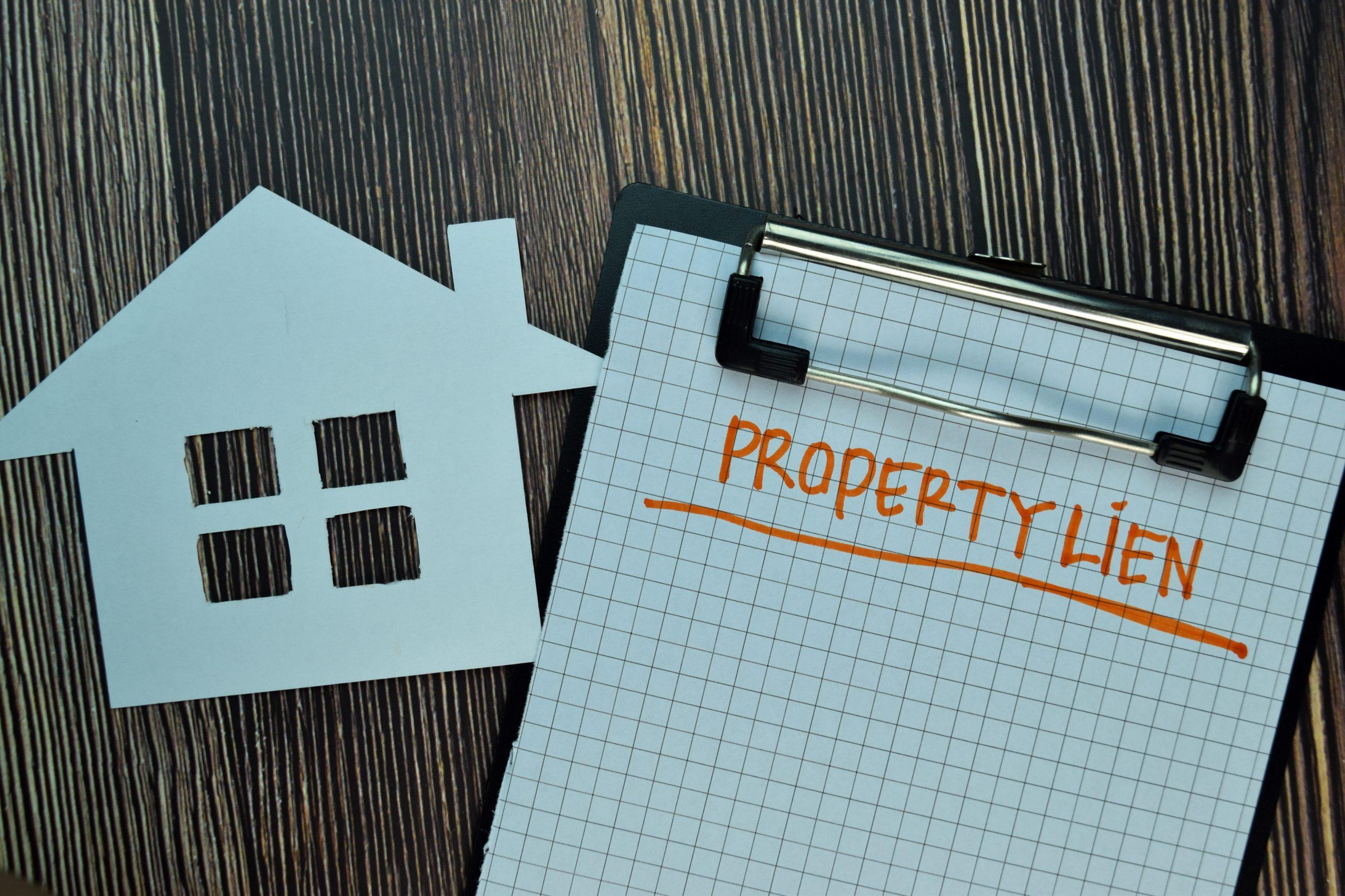 property lien written on clipboard